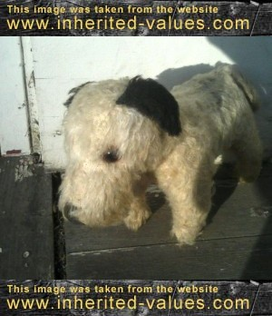 old-stuffed-terrier-dog