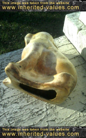 back and bottom of antique composition dog
