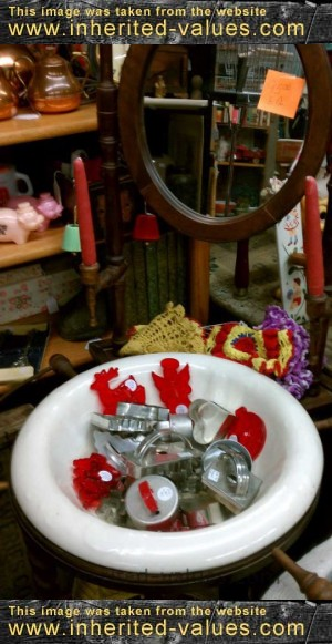 antique washstand with cookie cutters