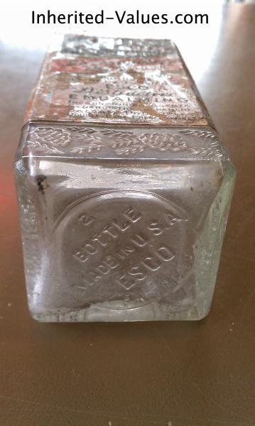 patent pending esco embalming fluid bottle